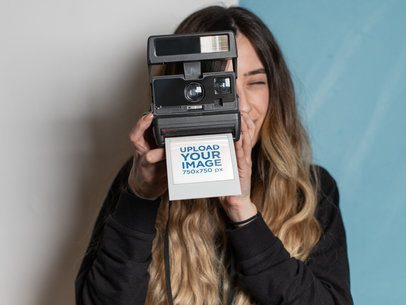 Polaroid Frame Mockup Featuring a Woman Taking a Picture with Her Instant Camera 26303