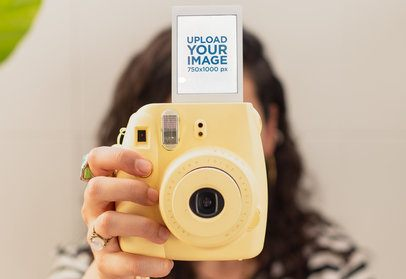 Polaroid Frame Mockup of a Woman Holding Her Colorful Instant Camera 26302