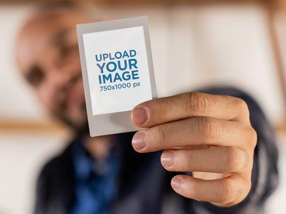 Instax Frame Mockup of a Man Holding His Instant Picture 26294