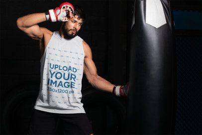 Tank Top Mockup of an MMA Fighter Hitting a Punching Bag 26237