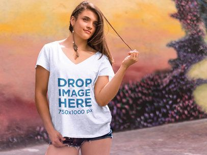 Girl Standing in Front of a Mural T-Shirt Mockup a7617