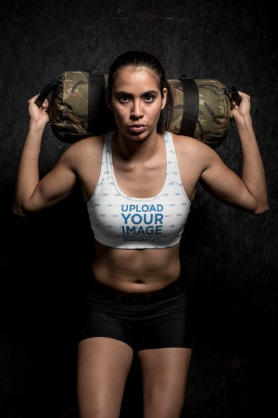 Sports Bra Mockup of a Sportive Woman Holding a Weight Bag 26264