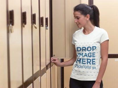 Woman at a Gym's Locker Room T-Shirt Mockup Template a7999