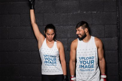 Tank Top Mockup Featuring Two MMA Athletes Against a Brick Wall 26240