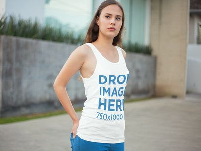 Young Woman Standing Outside her Home Tank Top Mockup a7897