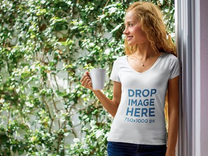 Young Woman Having a Coffee at Home T-Shirt Mockup a7804