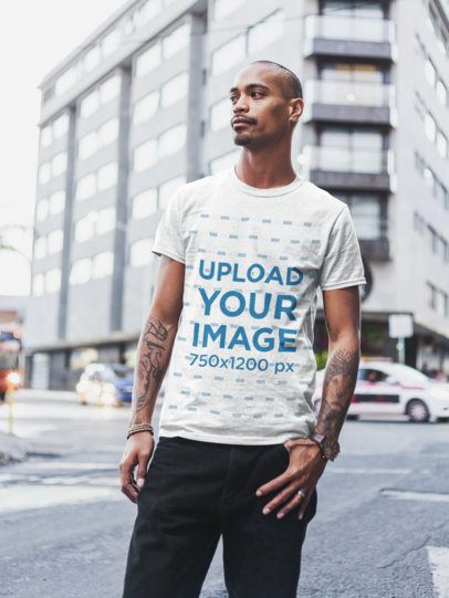 Heather T-Shirt Mockup of a Bearded Tattooed Man Standing by the Street 23996