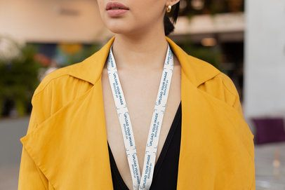 Lanyard Mockup of a Woman in a Yellow Trench Coat 26525
