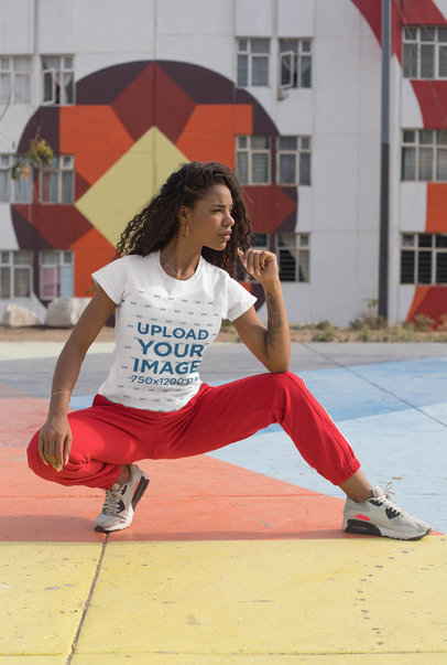 Tee Mockup of a Sporty Woman Posing in a Colorful Urban Scenario 27344a