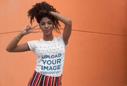 T-Shirt Mockup of a Kinky-Haired Woman Making a Peace Sign 27346