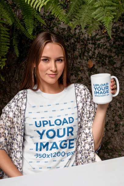 Mockup of a Trendy Woman Wearing a T-Shirt While Holding a 15 oz Mug 27509
