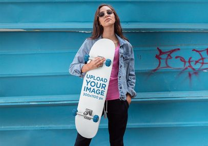 Mockup of a Woman Holding with Sunglasses Holding a Skateboard 27122