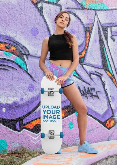 Skateboard Mockup of a Woman Standing Against a Graffitied Wall 27123