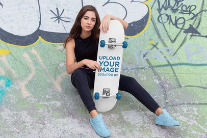 Skateboard Mockup Featuring a Woman Sitting on a Skate Ramp 27125
