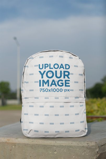 Backpack Mockup on a Concrete Column at an Open Natural Area 27700