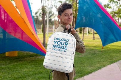 Mockup of a Teenager Holding a Backpack over His Shoulder 27703