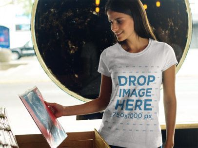 Smiling Pretty Lady at a Record Store T-Shirt Mockup a8296