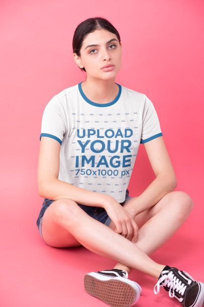 Ringer T-Shirt Mockup Featuring a Woman Sitting on the Floor of a Studio 27179
