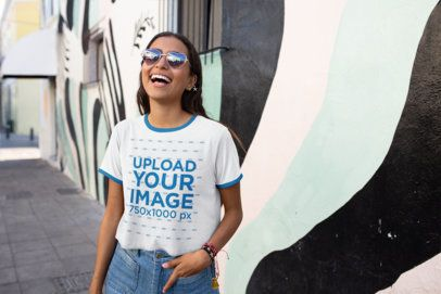 Ringer T-Shirt Mockup Featuring a Happy Woman in Front of a Street Art Mural 27266