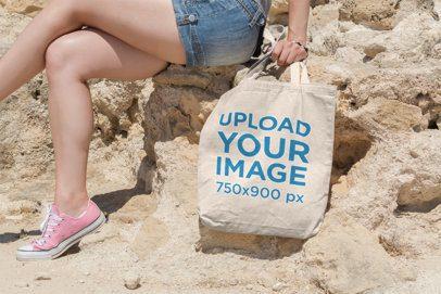 Tote Bag Mockup Featuring a Woman at a Rocky Hill 10-el