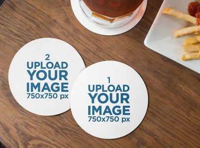Mockup of Two Round Coasters Lying on a Wooden Table by Some Fries 27802