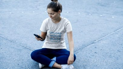 T-Shirt Video of a Woman Sitting on the Floor Watching Her Phone 12887