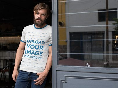 Mockup of a Blonde Man Wearing a Ringer Tee Next to a Window 27917