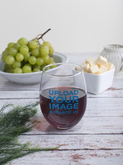 Stemless Wine Glass Mockup Next to Some Cheese and Fruit 27938