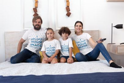 T-Shirt Mockup of a Family of Four Watching TV on a Bed 28061