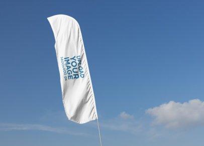 Mockup of a Flag Banner Against a Blue Sky 28030