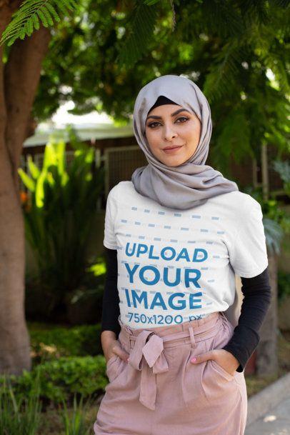 T-Shirt Mockup of a Woman Wearing a Hijab at the Park 28290