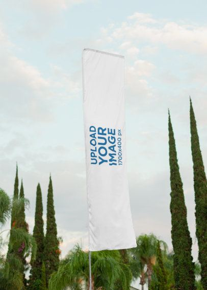 Flag Banner Mockup Featuring a Cloudy Sky and Some Trees 28021