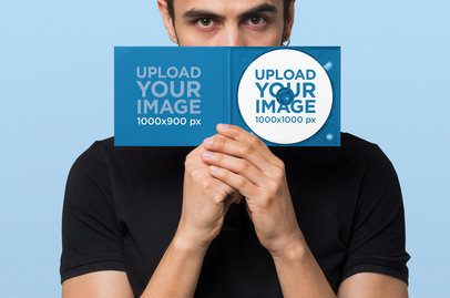 Mockup of a Man Hiding His Face Behind a Digipak with a CD 28330
