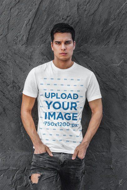 T-Shirt Mockup Featuring a Man Standing Against a Dark Wall 420-el