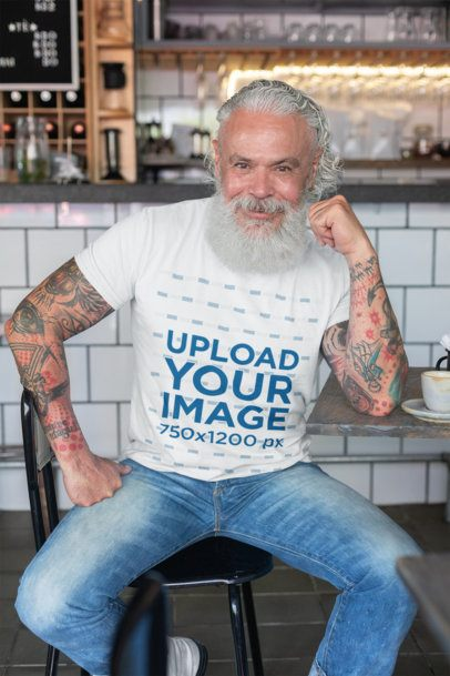 T-Shirt Mockup of a Tattooed Man at a Cafe 28416