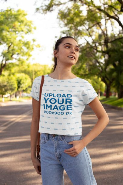 Crop Top Mockup Featuring a Young Woman in a Street Full of Trees 28572