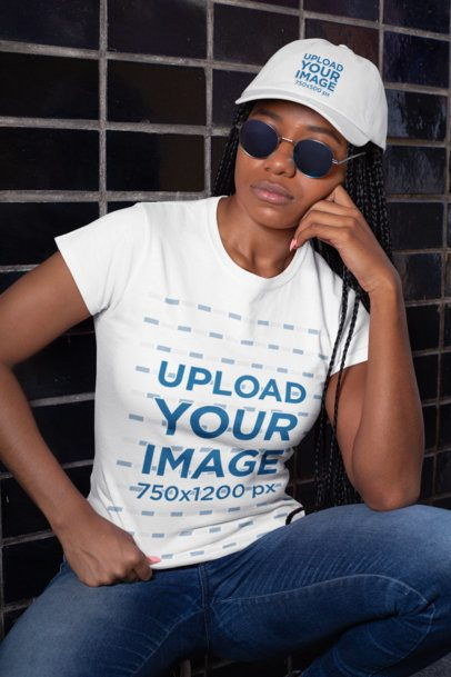 T-Shirt Mockup of a Woman Wearing a Dad Hat and Sunglasses by a Tiled Wall 28560