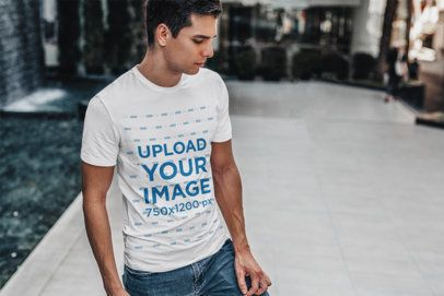 T-Shirt Mockup Featuring a Man Standing by a Modern Fountain 428-el