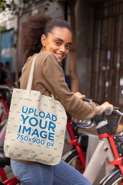 Mockup of a Customizable Strap Tote Bag Featuring a Woman with a Bike 28850