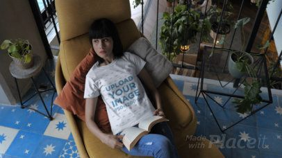 T-Shirt Video of a Woman Reading on a Yellow Couch 28916