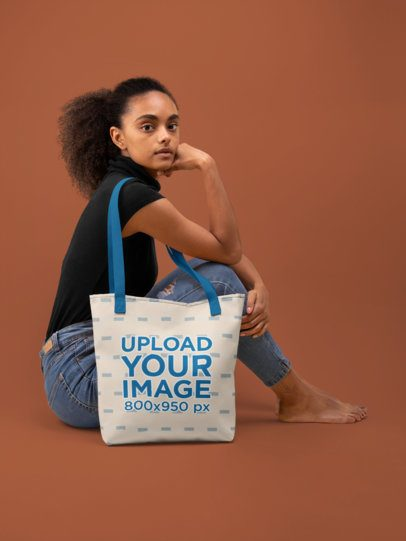 Tote Bag Mockup of a Woman Sitting on the Floor of a Studio 28867
