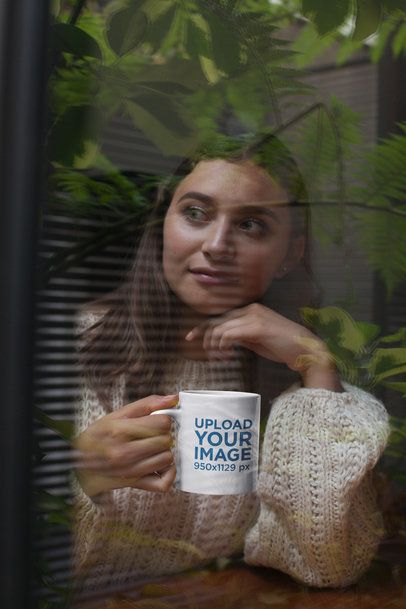 Mockup of a Woman Holding an 11oz Mug Against a Reflection of Tree Leaves 29154