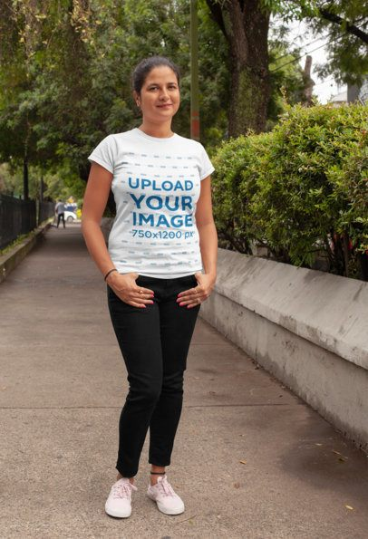 T-Shirt Mockup of a Kind-Looking Woman Posing in a Park Lane 28934