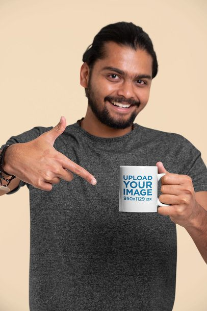 Mockup Featuring a Joyful Man Pointing at an 11 oz Coffee Mug 29092