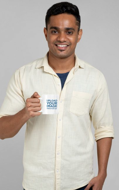 Mockup of a Man Holding an 11 oz Coffee Mug in a Studio 28961