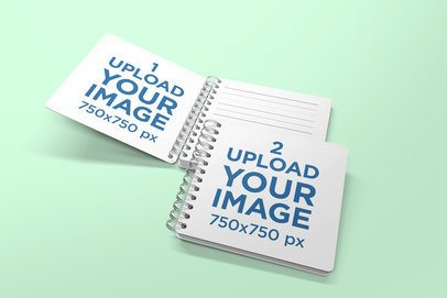 Mockup Featuring an Opened and a Closed Spiral Notebook Against a Solid Color Backdrop 477-el