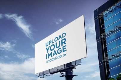 Billboard Mockup Featuring a Tall Building and Blue Skies 371-el