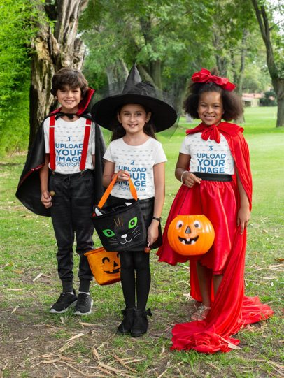 T-Shirt Mockups of Three Kids with Halloween Costumes in the Park 29307