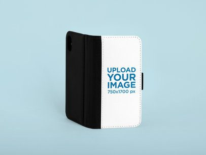 Mockup of an iPhone XS Wallet Case Standing Against a Plain Background 29227