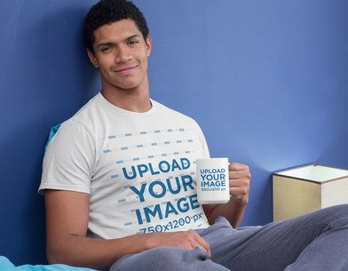 T-Shirt Mockup of a Man Holding a 15 oz Mug in Bed 29260